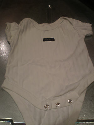 Next pair of white vests and two other vests Size 3- 6 mths