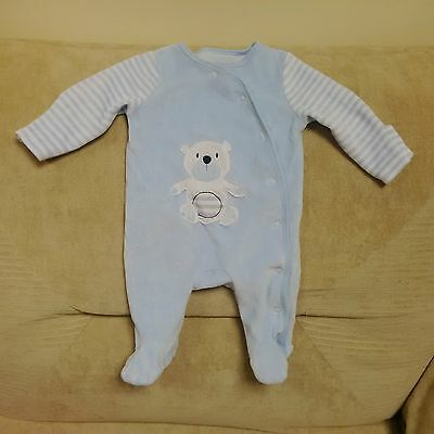 0-3 months unisex sleepsuit in blue with teddy on the front & press-studs down