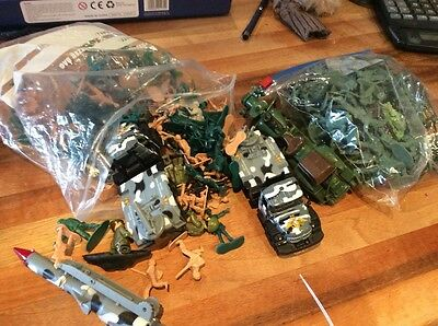 Two Bags Of Toy Soldiers And Tanks