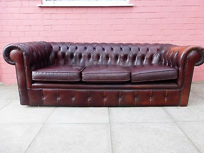 A Brown Leather Chesterfield Three Seater Sofa *DELIVER AVAILABLE