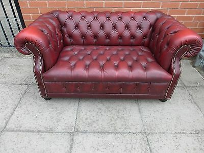 An Oxblood Red Leather Chesterfield Buttoned Sofa Settee