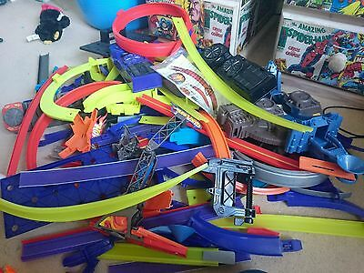 Huge collection of hot wheel tracks, stickers, x3 battery launchers
