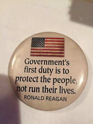 Government 's first duty is to protect not run lives Ronald Reagan button pin
