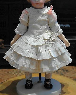 Dress for the antique French or German doll.