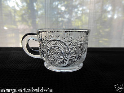 L E Smith Glass Clear Pinwheel & Star Slewed Horseshoe 5 ounce Punch Cup