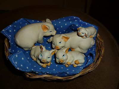 Cute group of Bisque Porcelain pigs in a basket
