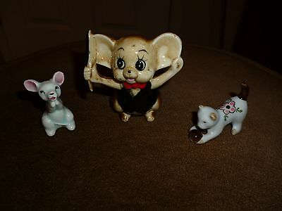 Small group of porcelain animals. two mice and a cat
