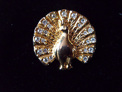 Lovely little gold tone and diamante Peacock brooch