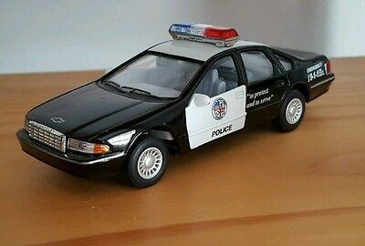 Die Cast Chevy Caprice Police Car LAPD Scale1:43 by Kinsmart