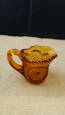 """EAPG Child's Amber Glass Cream Pitcher in Pattern """"Chimo"""""""