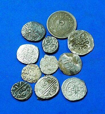 Lot of 11 Islamic Coins.r