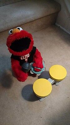 Lets Rock Elmo w/Drums, Tambourine and Microphone. Used.