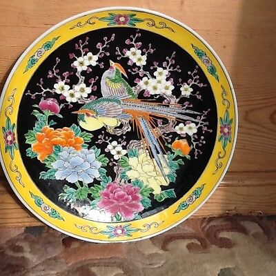 A large Japanese plate enamelled with exotic birds and blossom