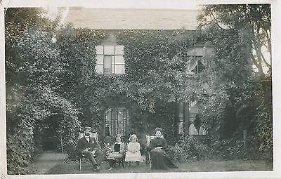 FAMILY GROUP,  Posing in Garden of their Home Vintage 1904 Postcard (O07