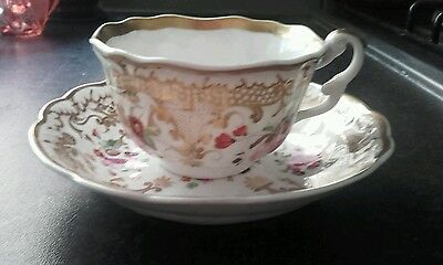 Vintage beautifully hand painted floral and gilt decorated cup and saucer/dish