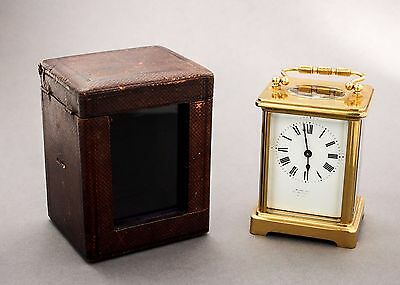 Vintage brass carriage clock travel case Roman numerals enamel dial single train
