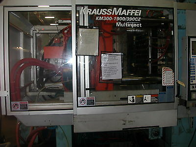 2002 Krauss Maffei 330 Ton Two-Color, Two-Shot Injection Molding Machine