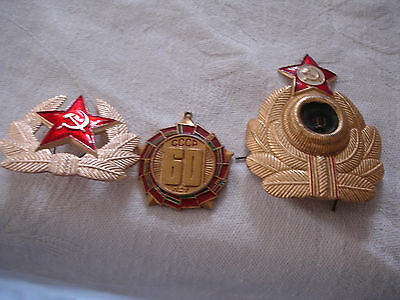 2 Soviet  military badges and 60 years of USSR  decorative medal from 1980s