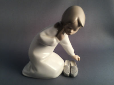 Lladro Young Girl with Slippers Figure.