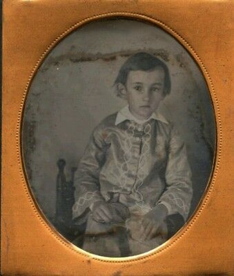 odd Victorian 6th plate daguerreotype of child in strange clothes