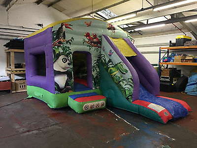 Jungle themed Bouncy Castle with slide by Air Inflatables. Good Condition.
