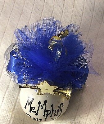 Memphis 2016 Christmas Ornament Blue Bow/Mesh adorned with a Musical Instrument