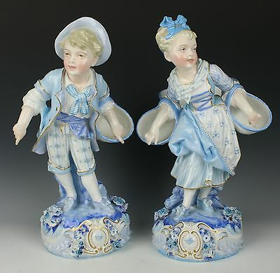 Antique 19C french Levy & Cie pair of figurines Boy and Girl with Baskets