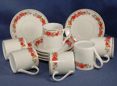 Set of 6 Coffee Cans & Saucers in a Red & Mauve Floral Pattern