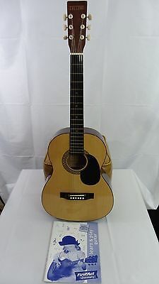 Accoustic Guitar by Telleno and First Act Discovery Instruction Book