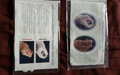 2- White gloves for handel coins and a album with pages for holding coins .