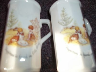 vintage Holly Hobbie salt and pepper shakers 3 inch high with handels never used