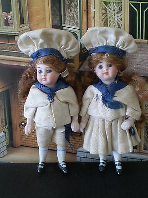 """Couple Of French All Bisque Dolls . All Original  . 3 1/8 """" . 8 Cm . 2 Straps"""