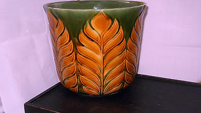 Large Dark Green Plant Pot Holder / Jardinaire With Large Brown Leaves To Side