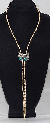 Vintage Sterling Silver Covered Wagon With Turquoise Wheels Gold Cord Bolo Tie