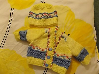 Newborn baby hand knitted cardigan and hat set