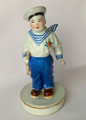 Beatiful Vintage Chinese Porcelain Figurine the Boy young Sailor, with defects