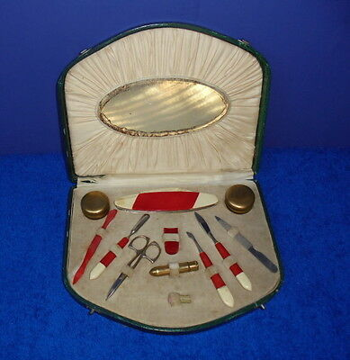 Vintage 12 piece manicure set in green hinged box Red & Ivory color tools