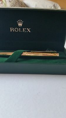 18 carat yellow gold Rolex  pearlmaster  domed  bezel gold style wave design pen