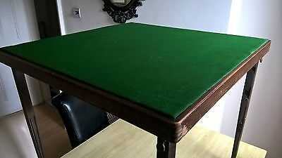 Antique card table with folding legs for easy storage