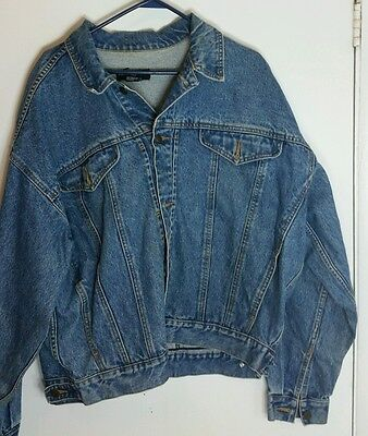 Warner Brothers xl jean jacket with characters embroidered on back.