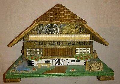 Charming vintage chalet music box with turning water wheel nice tune