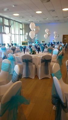 100 white spandex chair covers and 100 sashes HIRE ONLY