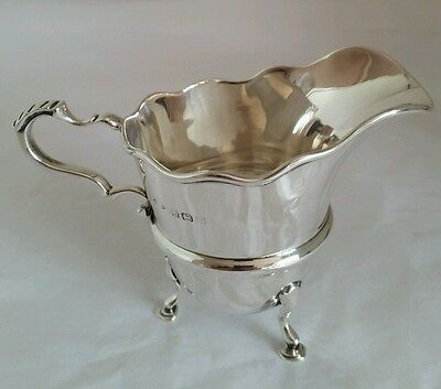 A George V sterling silver cream jug. Birmingham 1920. By James Woods & Sons