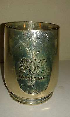 An antique silver plated tankard dated 1938