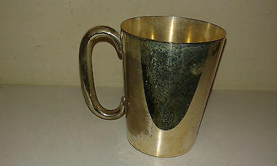 A pint sized silver plated tankard