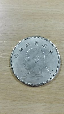 an old Chinese coin. Silver ?