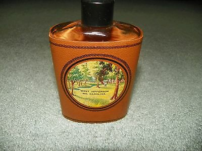 Vintage Leather Covered Glass Comedic Souvenir Flask From North Carolina