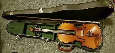 Childs practice violin. Needs new strungs. Includes bow.