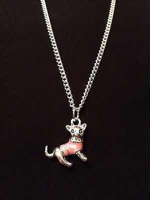 Lovely silver coloured Chihuahua in a cute pink enamelled coat necklace