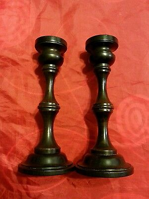 Pair of antique ebony wood candlesticks with metal cups. 6 1/4""
